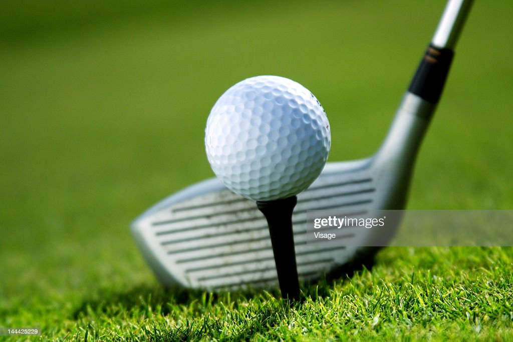Close-up of golf ball and club