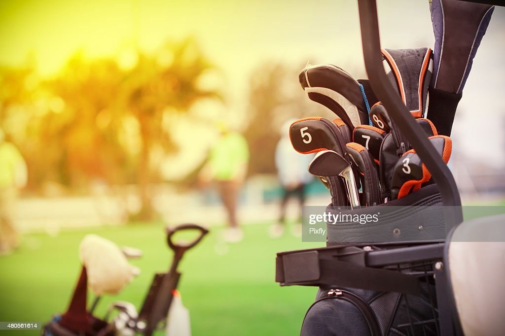 closeup of golf club in bag on golfer background : Stock Photo