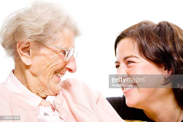 Close-up of grandmother and granddaughter smiling together