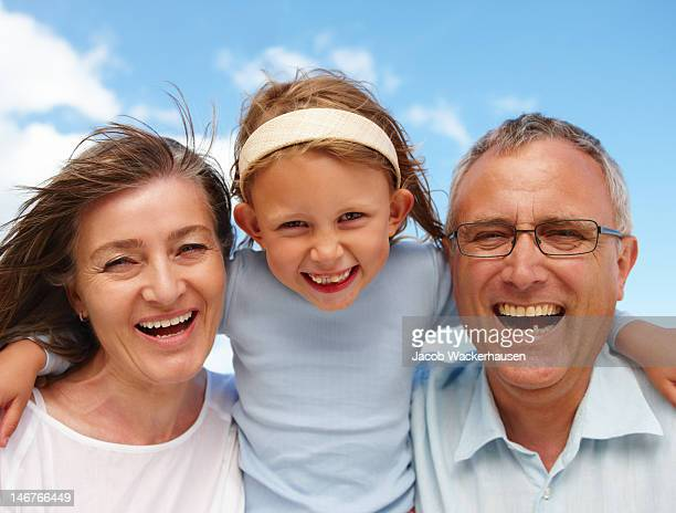 Close-up of grandparents with granddaughter having fun