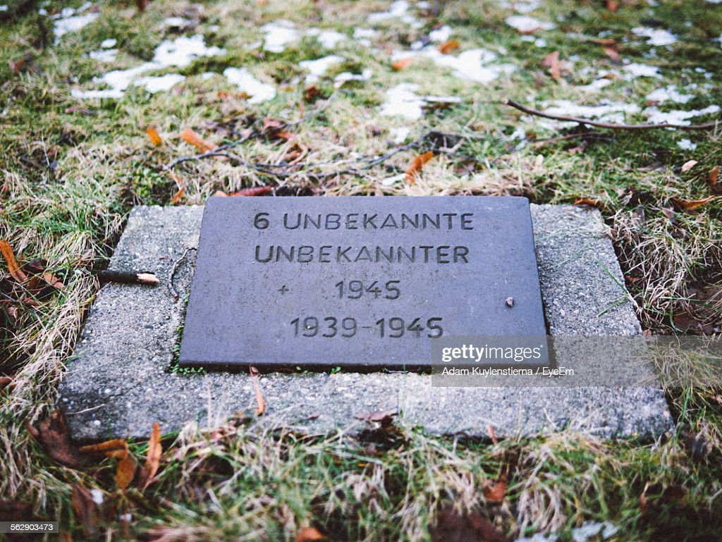 Close-Up Of Gravestone In Cemetery In Berlin