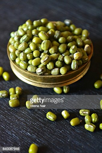 Close-up of Green gram/Mung bean/Moong Dal in a brass utensil
