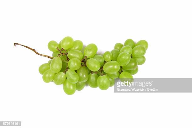 Close-Up Of Green Grape Bunch On White Background