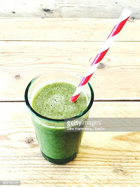 Close-Up Of Green Juice Served On Table
