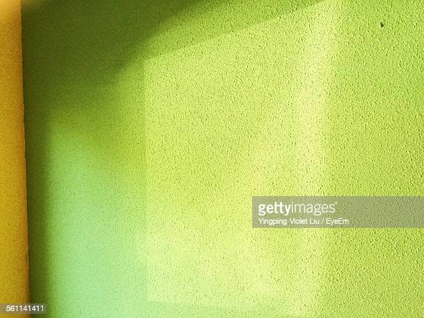 Close-Up Of Green Painted Wall