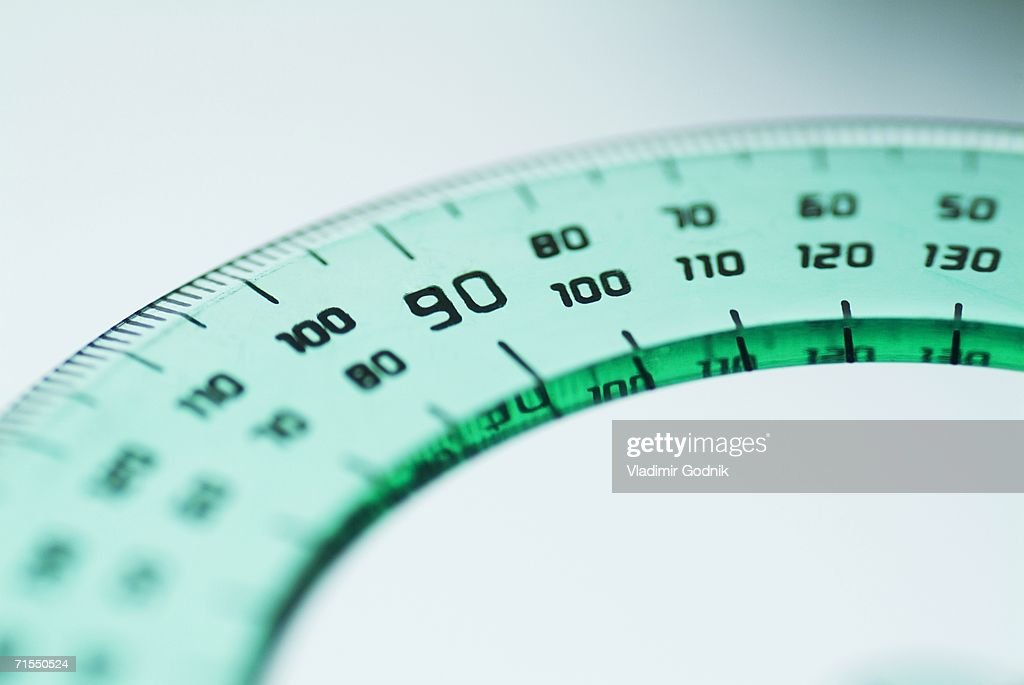 Close-up of green plastic protractor