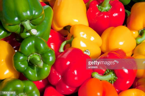 Close-up of green, red and orange bell peppers