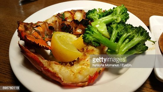 Closeup Of Grilled Lobster With Broccoli In Plate On Table ...