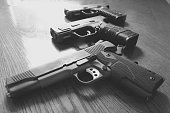 Close-Up Of Guns On Table