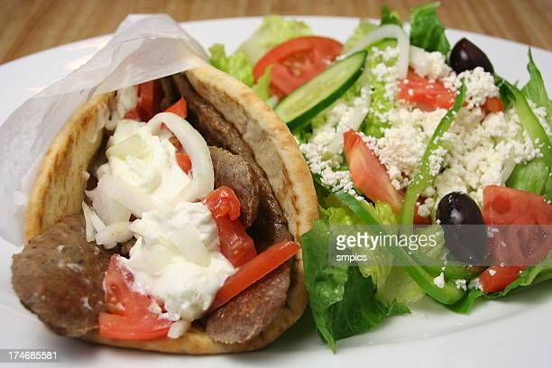 Close-up of gyros with feta salad