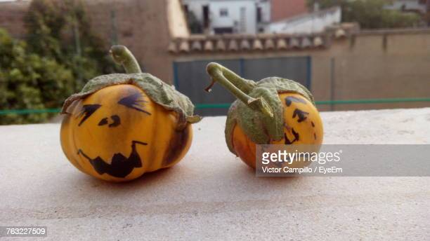 Close-Up Of Halloween Pumpkins On Retaining Wall