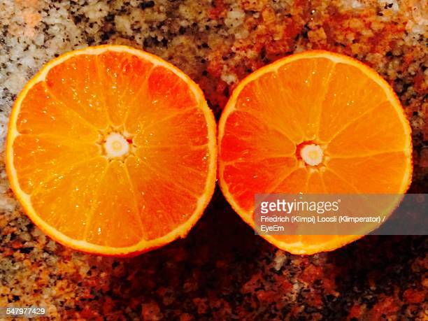 Close-Up Of Halved Oranges On Table