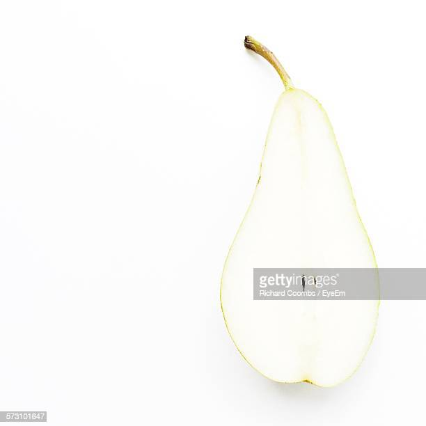 Close-Up Of Halved Pear Against White Background