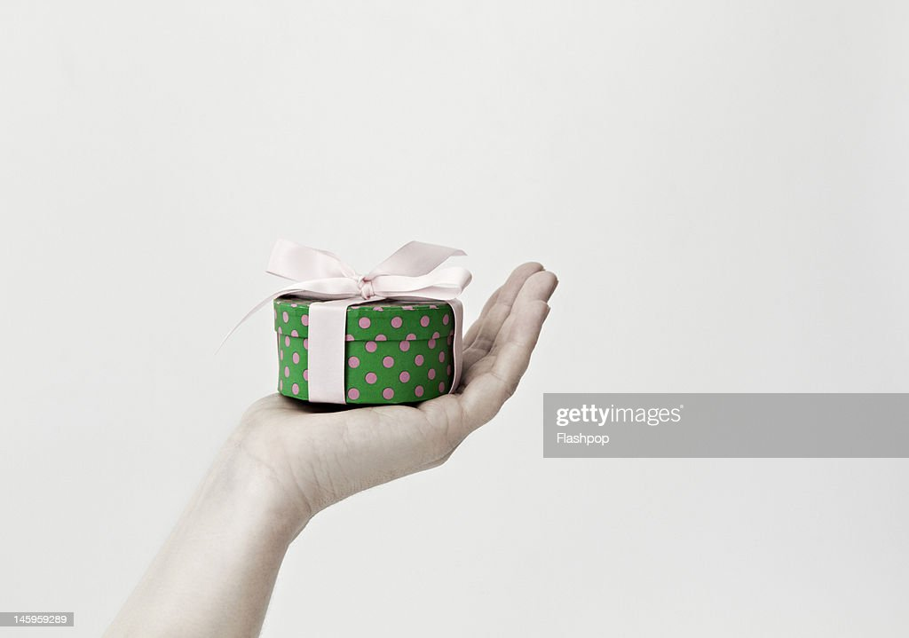 Close-up of hand holding a gift : Stock Photo
