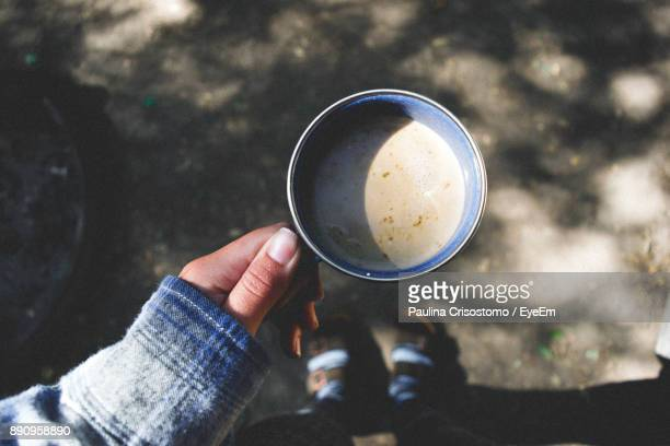 Close-Up Of Hand Holding Coffee Cup On Street