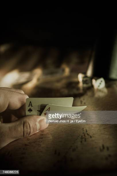 Close-Up Of Hand Holding Playing Card
