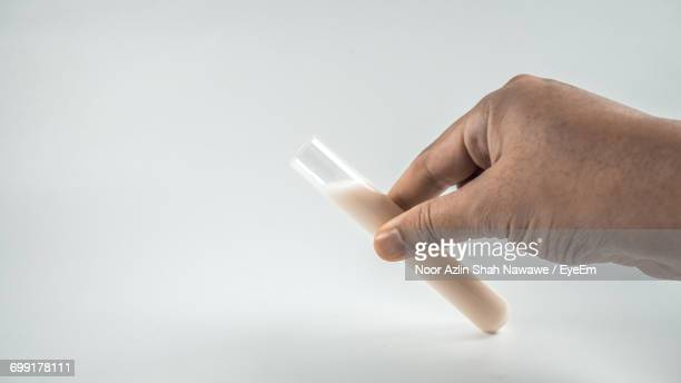 Close-Up Of Hand Holding Test Tube