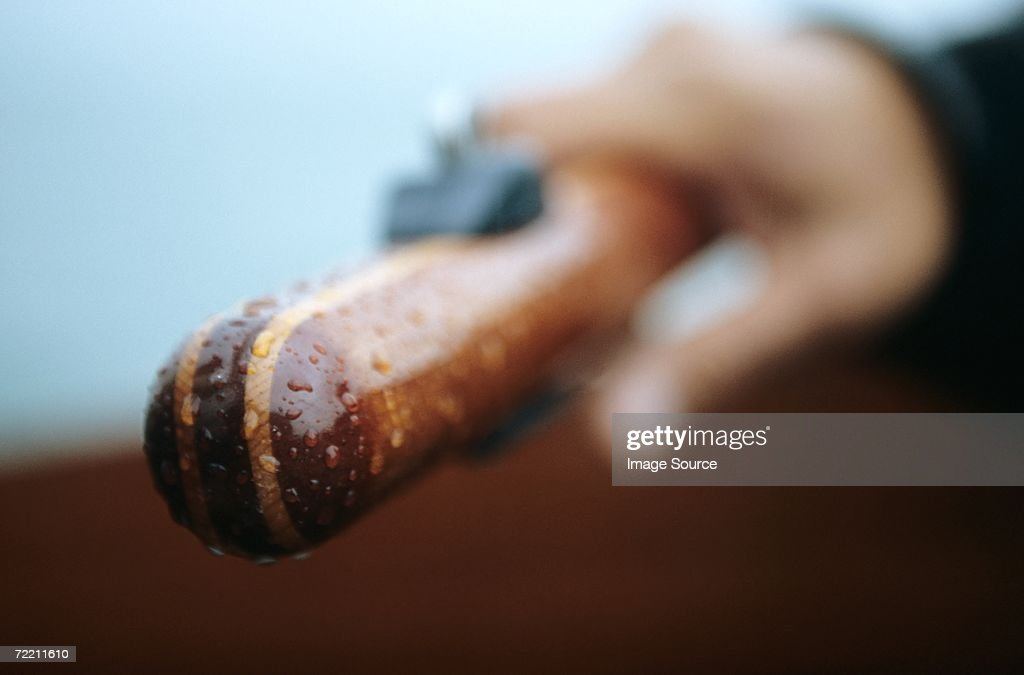 Close-up of hand holding wooden handle