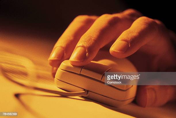 Close-up of hand on computer mouse