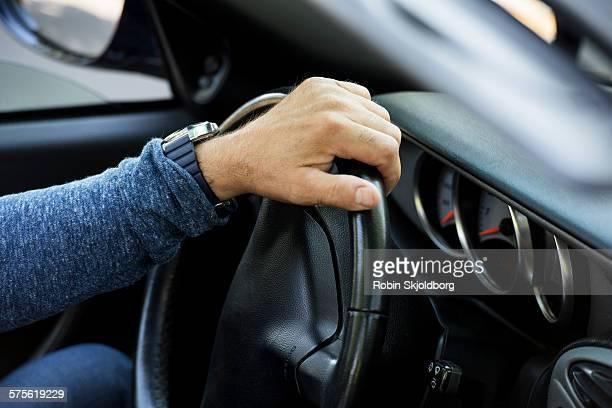 Closeup of hand on steering wheel