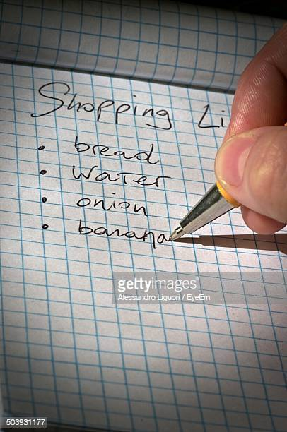 Close-up of hand writing shopping list