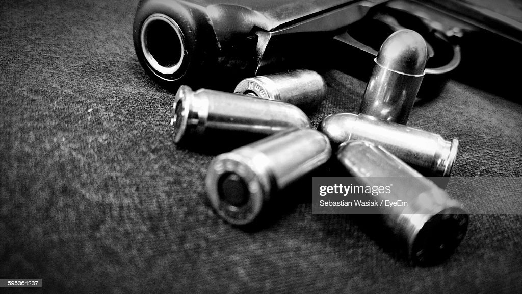 Close-Up Of Handgun And Bullets : Stock Photo
