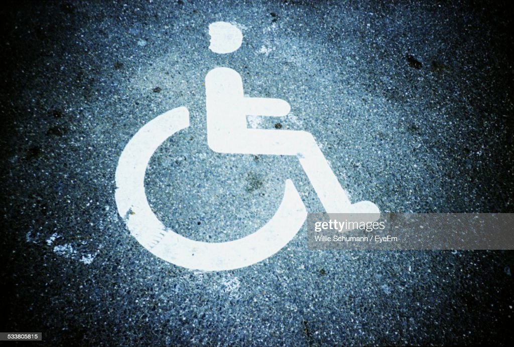 Close-Up Of Handicapped Sign On Road