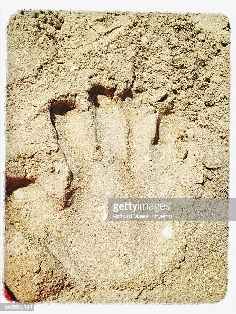 Close-Up Of Handprint In Sand