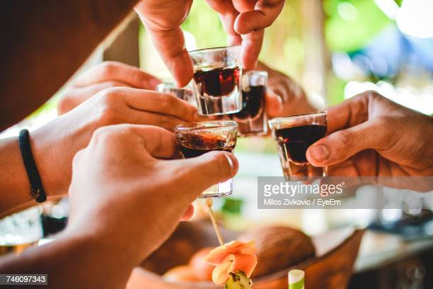 Close-Up Of Hands Doing Shots