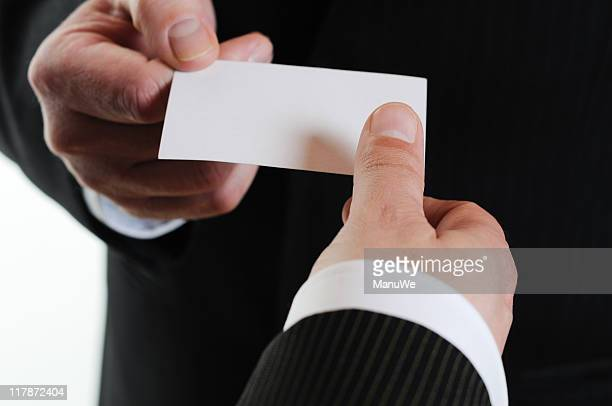 Closeup of hands exchanging a business card