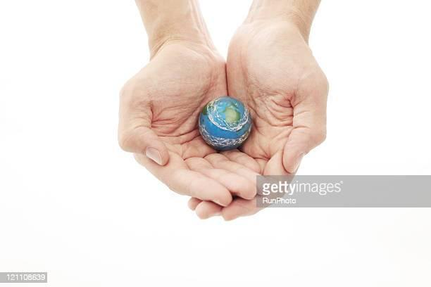 closeup of hands holding globe