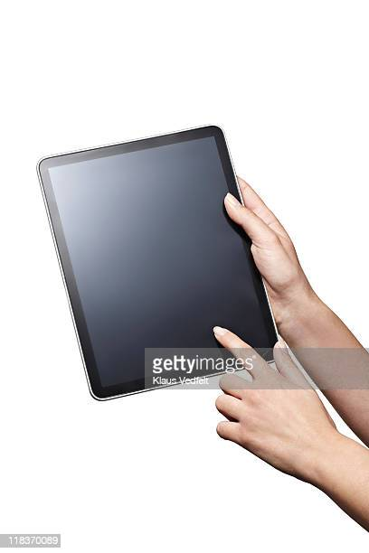 Closeup of hands holding  tablet
