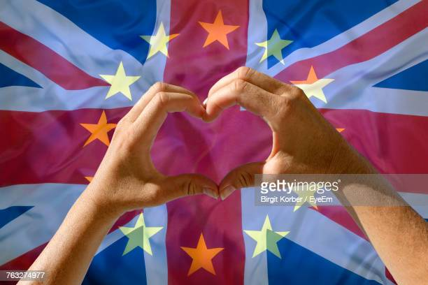 Close-Up Of Hands Making Heart Shape Against British Flag