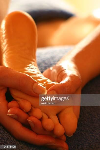 Close-up of hands massaging a foot