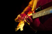 Closeup of hands playing electric guitar