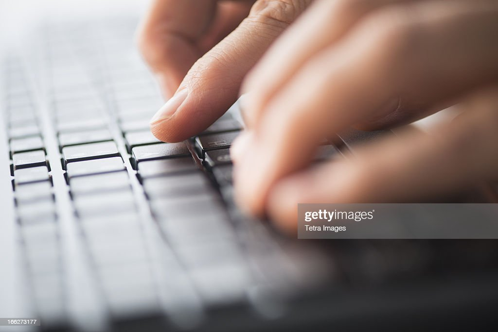 Close-up of hands typing on keyboard : Stock Photo