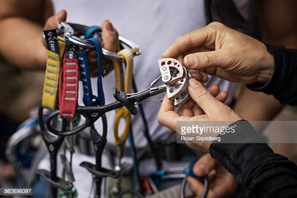 Closeup of hands with climbing equipment