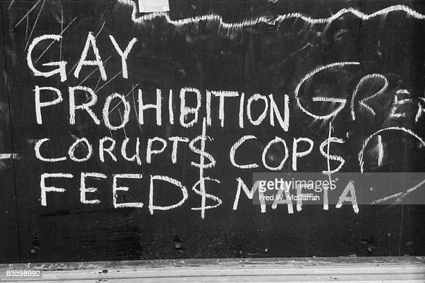 Closeup of handwritten chalk text on a boardedup window of the Stonewall Inn after riots over the weekend of June 27 1969 The text reads 'Gay...