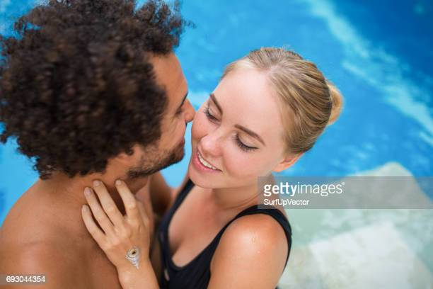 Closeup of Happy Couple Embracing in Swimming Pool