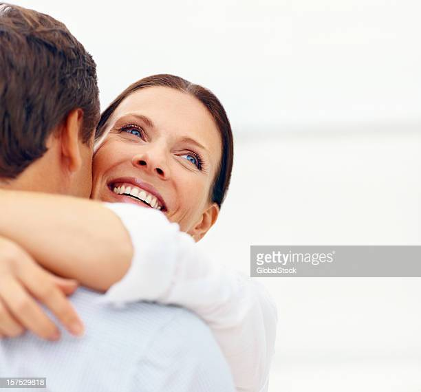 Close-up of happy woman embracing her partner