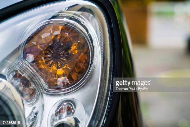 Close-Up Of Headlights Of Car