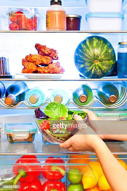 Close-up of Healthy Salad in Front of Open Refrigerator