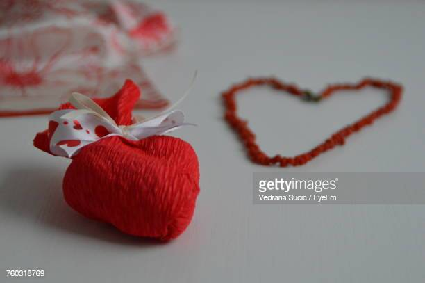 Close-Up Of Heart Shape Gift Over White Background