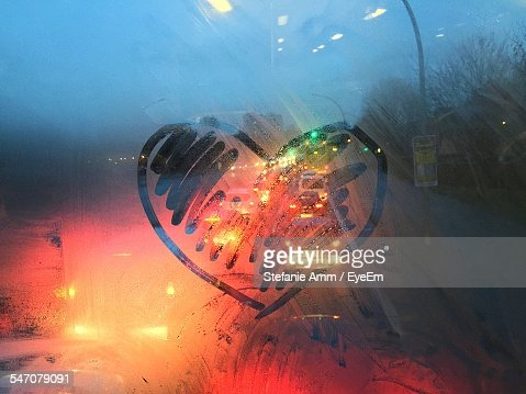 Close-Up Of Heart Shape On Condensed Window