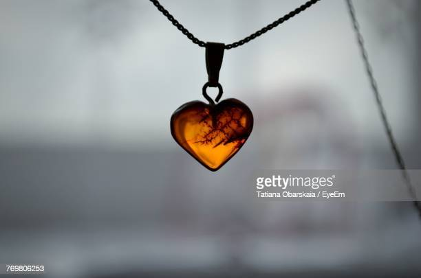 Close-Up Of Heart Shape Pendant Hanging On Chain