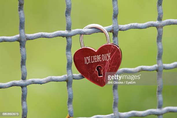Close-up Of Heart-shaped Lock On Fence