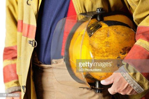 Closeup of Helmet Held By Firefighter