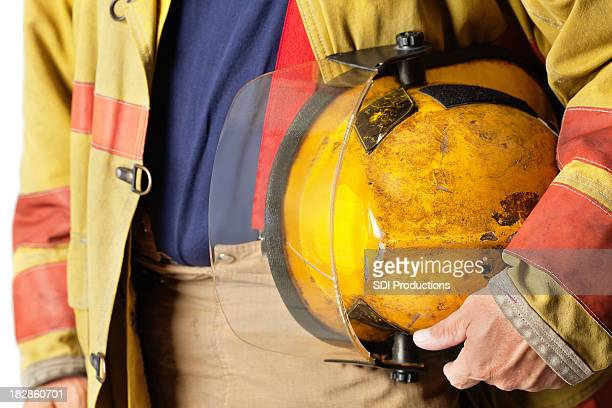Closeup of Helmet Held By Firefighter
