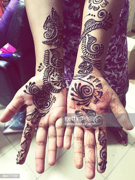 Close-Up Of Henna Design On Hands