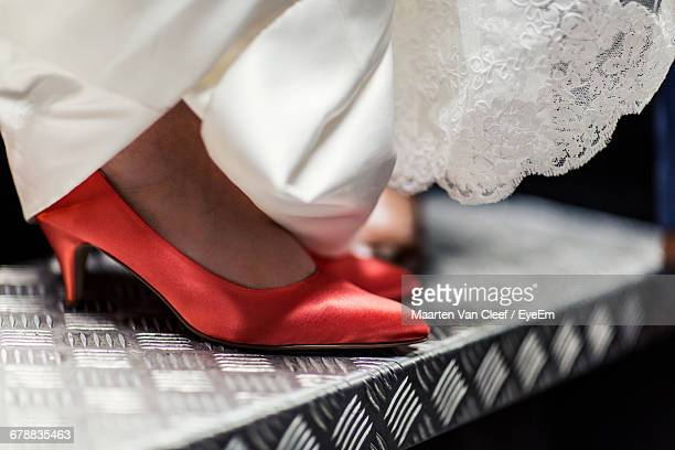Close-Up Of High Heels And Wedding Dress